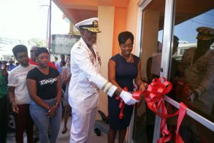 Secretary of Tourism, Culture and Transportation Nadine Stewart-Phillips cuts the ribbon together with Chairman of the Tobago Festivals Commission George Leacock to declare the Scarborough building as the new headquarters of the Committee.