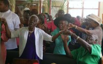 Members of the church's congregation join together in song.