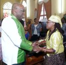 THA Chief Secretary greets a member of the congregation.