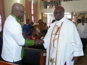 THA Chief Secretary greets Bishop Claude Berkeley.