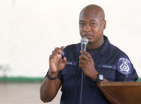 Constable Rondell James speaks to the pupils during the event.