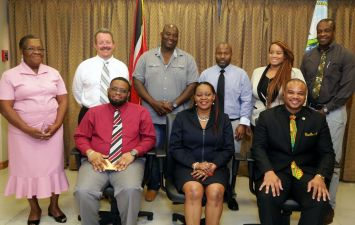 Secretary of the Division of Infrastructure, Quarries and the Environment Kwesi Des Vignes, (seated front right) and Administrator in the Division Ritchie Toppin (front left) take a group photo with the newly installed North East Management Trust at the Division's conference room on Monday afternoon.Seated with them are Chairman of the Board Claire Davidson-Williams, and standing from left are members Laura Williams, James Morsehead, Deputy Chairman Bertil Taylor, Jason Arthur, Sheena Des Vignes and Selwyn Davis.