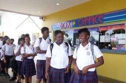 Students await watching the screening of Black Panther at MovieTowne Tobago.