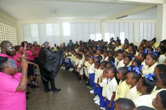 Students of Mason Hall Government Primary school watch the skit attentively put on by the SSU caravan.