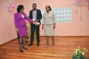 Secretary of Community Development, Enterprise Development and Labour Marslyn Melville Jack, left and Administrator in the Division Cheryl Ann Solomon view the stage at the refurbished centre.