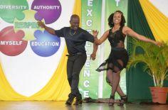 Teachers Xavier King and Keisha Clarke dance on stage, entertaining the crowd.