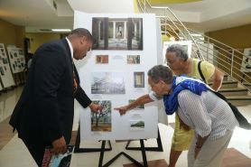 Amateur photographer Margaret Hinkson shows Secretary of Infrastructure, Quarries and the Environment Kwesi Des Vignes the photographs she took in Tobago, which now form part of the Details exhibition being put on by the National trust at the Scarborough Library. With them is Chairman of the Trust Margaret McDowall.