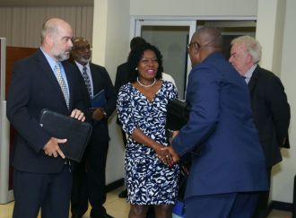 From left Secretary of the Trinidad and Tobago Chamber of Commerce Peter Agard looks on as Secretary of Community Development, Enterprise Development and Labour Marslyn Melville-Jack greets management committee member Curtis Williams.