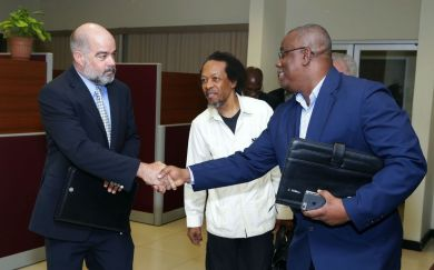 From left Secretary of the Trinidad and Tobago Chamber of Commerce Peter Agard greets management committee member Curtis Williams, and at centre Dr Vanus James.