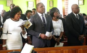 Secretary of Community Development, Enterprise Development and Labour Marlsyn Melville Jack, Secretary of Finance and the Economy Joel Jack, Catherine Charles, and Chief Secretary Kelvin Charles sing during the funeral service.