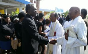 Arch Deacon Kenneth Forrester, right, shakes the hand of His Excellency Orville London, High Commissioner of the Republic of Trinidad and Tobago to the United Kingdom of Great Britain and Northern Ireland. Reverend Hilton Bonas stands at left.