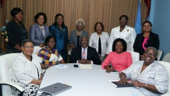 Seated in front row from left are : College President Dr Gillian Paul, Vice-Chairman of the board of trustees Dr Rita Pemberton, Chief Secretary Kelvin Charles, Secretary of the Division of Community Development, Enterprise Development and Labour Marslyn Melville-Jack, Advisor to the Secretary of Education Dr Verleen Bobb-Lewis.Standing (l to r) Dr Alvinelle Matthew, Dr Joycelyn Francois, June Alexis-Matthew, Dr Anna-May Edwards-Henry, Dr Camille Samuel, Dr Joan Bobb-Ward and Dr Naseem Koylass.