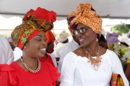 Secretary of Tourism, Culture and Transportation Nadine Stewart-Phillips (left) chats with wife of the Chief Secretary, Mrs Catherine Charles (right).