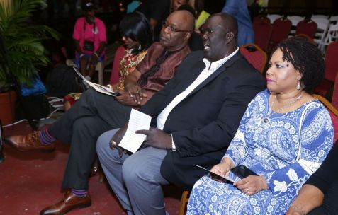 From left, Chief Secretary Kelvin Charles, Pastor Glenroy Frank, and THA Presiding Officer Denise Tsoiafatt-Angus enjoy the performance.