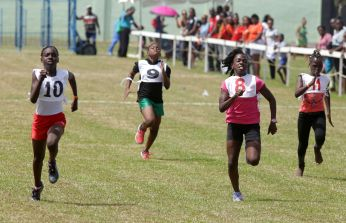 J'Alisia Alexander, left, runs to win the girls under 11 100M race ahead of Q-Jehea Stewart (second from right) and Kelly Kerr.