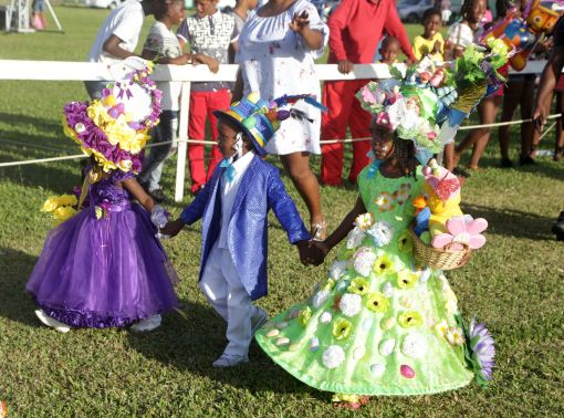 Children parade along the race track during the Easter Bonnet competition.