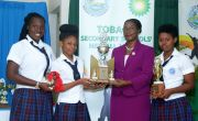 Administrator of the Division of Sport and Youth Affairs Wendy Guy-Hernandez, presents Scarborough Secondary students, from left, Naomi Alexander, Bryann Mark and Karina McDougall, with the senior knockout challenge trophy.