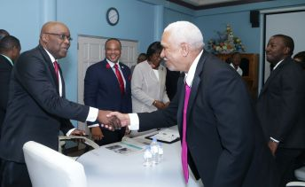 Chief Secretary Kelvin Charles, left, greets UDeCOTT chairman Noel Garcia prior to the start of the meeting. Also in photo are Secretary of Infrastructure, Quarries and the Environment Councillor Kwesi Des Vignes, second from left, to his right, Secretary of Health, Wellness and Family Development Dr Agatha Carrington, and right, UDeCOTT director Jade Brown.