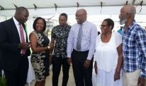 Assistant Secretary of the Division of Community Development, Enterprise Development and Labour Shomari Hector, left, shares a story with, from left, the Division's Secretary Marslyn Melville-Jack, animator Sekani Solomon, Chief Secretary Kelvin Charles and Sekani's parents, Gladstone and Sharon Solomon.
