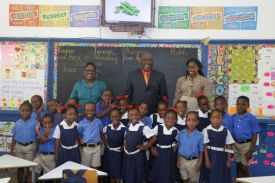 The students of Black Rock Government Primary School get their photo taken with Chief Secretary Kelvin Charles.