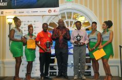 Third place winners, Kerville Cowie, third from left, and Shuffie Ali, fifth from left, take a photo with THA Chief Secretary Kelvin Charles and B-Mobile representatives.