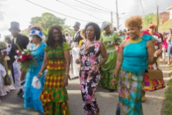 Catherine Anthony-Charles, wife of the Chief Secretary Kelvin Charles, Secretary of Community Development, Enterprise Development and Labour Marslyn Melville-Jack, and Minister of Community Development, Culture and the Arts Dr. Nyan Elizabeth Gadsby Dolly join the wedding procession.