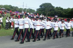 Members of the Defence Force march during the parade.