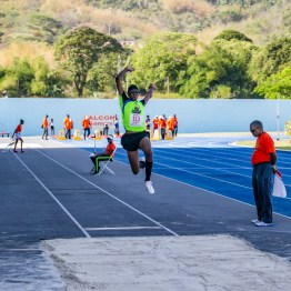 Aaron Antoine of Couva-based Neon Wolves Athletic Club competes in the long jump competition during the Falcon Games 2019 on Saturday (April 13, 2019) at Dwight Yorke Stadium in Bacolet.
