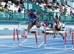 Antonia Sealy of Fulfilling Athletic Dreams Club leaps on her way to winning the women's 100m hurdles event, in a time of 15.15 seconds.