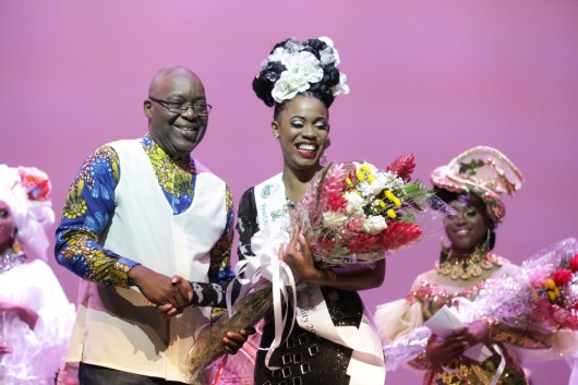Ms. Tobago Heritage Personality 2019, Moesha Bruce, is congratulated by THA Chief Secretary Hon. Kelvin Charles.