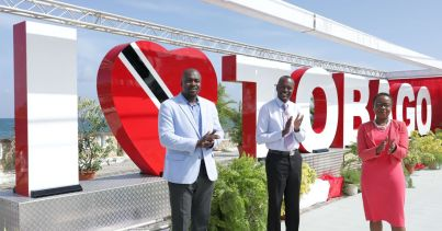 Chief Secretary Hon. Ancil Dennis (centre), Secretary of the Division of Settlements, Urban Renewal and Public Utilities Clarence Jacob (left) and the Administrator of the Division of Settlements, Urban Renewal and Public Utilities Myrna Mc Leod (right) stand before the 'I Love Tobago' sign on the Esplande, Milford Road, Scarborough. The sign was commissioned and unveiled on June 4, 2020.