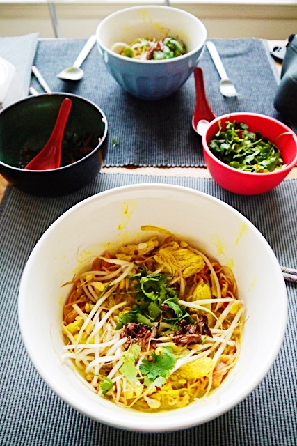 Who can resist Khao Soi with Chicken? Cozy egg noodles, creamy coconut milk broth dyed a bright, happy yellow from the turmeric, which has healing properties in it and so does the ginger!!, plus FRIED shallots sprinkled on top? Coziness and happiness all in one bowl! | thai-foodie.com