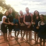 group of cooking stuents in front of our incredible view over the ocean
