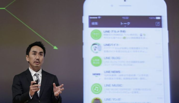 Takeshi Idezawa, chief executive officer of Line Corp., speaks during a news conference in Tokyo, Japan, on Tuesday, Dec. 1, 2015. Naver Corp.'s Line app, Japan's biggest messaging service, began a revenue sharing system with news media organizations that start their own channels on the system. Photographer: Kiyoshi Ota/Bloomberg via Getty Images