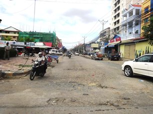 Photo: Dilapidated roads just outside Phnom Penh's city centre.