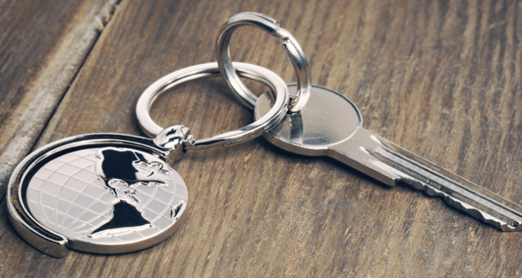 A globe keyring attached to a key