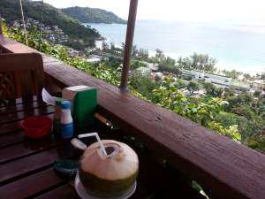 drinking coconut juice in Thailand