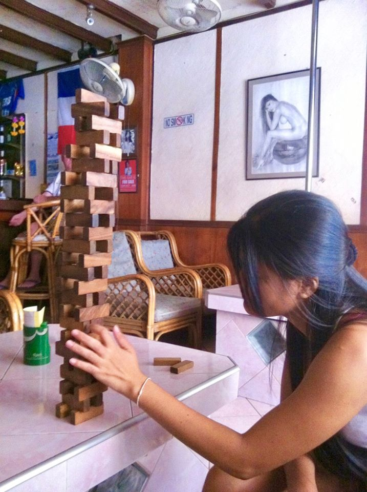 Sexy thai girl playing Jenga in Pattaya bar