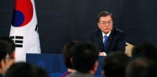 South Korean President Moon Jae-in answers reporters