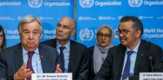 U.N. Secretary General, Antonio Guterres speaks while sitting next to Director General of the World Health Organization (WHO), Tedros Adhanom Ghebreyesus during an update on the situation regarding the COVID-19 (previously named novel coronavirus) at the World Health Organization (WHO) headquarters in Geneva, Switzerland, 24 February 2020. (Salvatore Di Nolfi/Pool via Reuters).