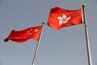 The Chinese and Hong Kong flags flutter at the office of the Government of the Hong Kong Special Administrative Region, 3 June 2020 (Photo: Reuters/Carlos Garcia Rawlins).