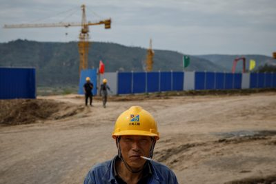 A worker stands outside a construction site of the Xinzhuang coal mine that is part of Huaneng Group's integrated coal power project near Qingyang, Ning County, Gansu province, China, 19 September 2020 (Photo: Reuters/Thomas Peter).