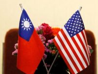 Flags of Taiwan and the United States are placed for a meeting in Taipei, Taiwan, 27 March 2018 (Photo: Reuters/Tyrone Siu).