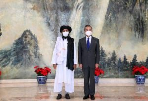 Chinese State Councilor and Foreign Minister Wang Yi meets with Mullah Abdul Ghani Baradar, political chief of Afghanistan's Taliban, in Tianjin, China 28 July 2021 (Photo: Li Ran/Xinhua/Reuters).