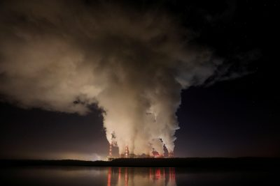 Smoke and steam billows from Belchatow Power Station, Europe's largest coal-fired power plant operated by PGE Group, at night near Belchatow, Poland 5 December 2018 (Photo: Kacper Pempel/Reuters).
