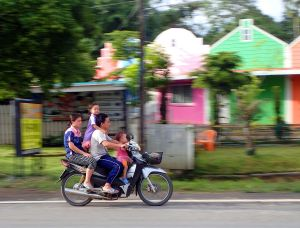 A family of 4 persons on a Honda scooter in Chiang Mai