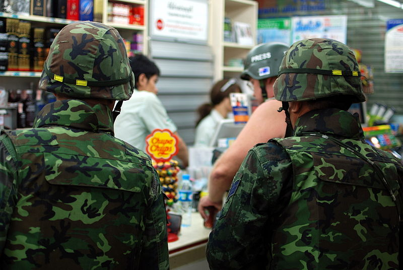 Soldiers at a 7-11 convenience store on Silom road