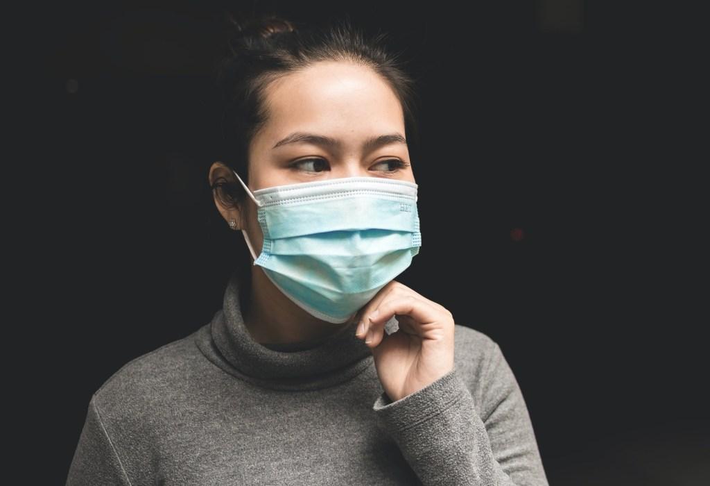 Asian girl wearing face mask.