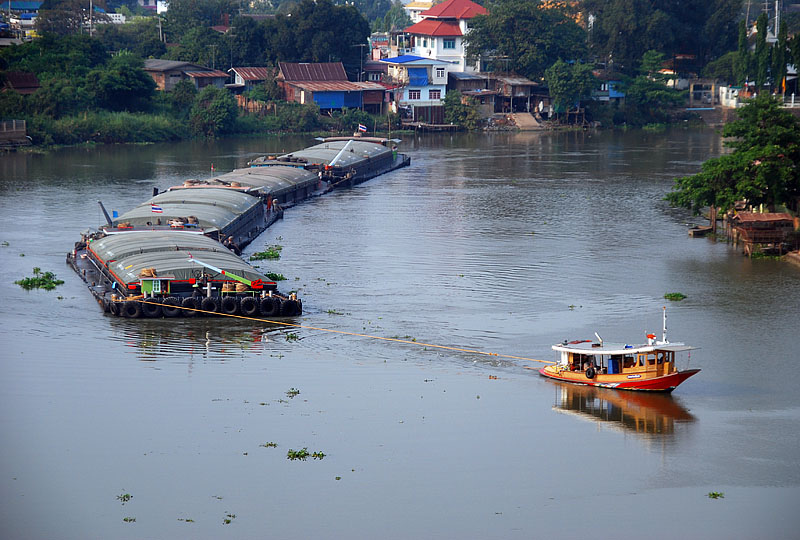 Barge and tug boat on the Pa Sak River in Ayutthaya