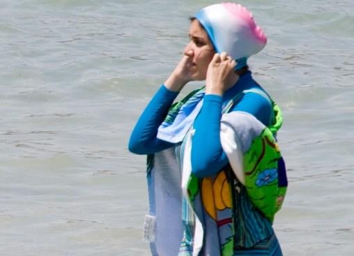 Woman wearing burkini swimwear